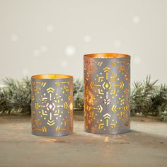 """Light glows warmly through the intricate openwork patterns of these handcrafted lanterns, handmade by artisans in India from partially recycled iron sheets. Pair with a votive or LED tea light (not included). Set of 2. Dimensions: Sm: 4 3/4""""h x 3 1/2""""dia; Lg: 8""""h x 4 1/4""""dia. Iron Sheet, Lantern Set, Green Gifts, Tea Lights, House Warming, Snowflakes, Recycling, Artisan, India"""