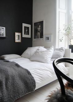 White bed linen with gray blanket throw