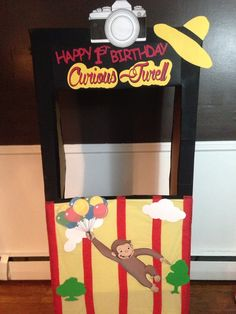 Curious George photo booth! Pictures are a must and why not have some cute props!!