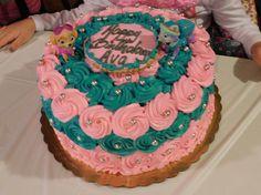 Pink and teal paw patrol cake
