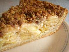 A twist on apple pie.  This is an absolutely delicious, creamy,  melt in your mouth apple pie.  The Walnut Streusel topping takes it to the next level.The photo is from Allrecipes.