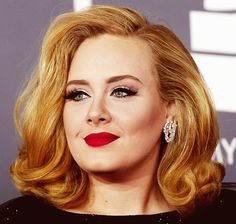 Classy, defined cat eye, neutral tones, and bright red lipstick. Go Adele!
