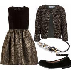 Bellissimo e molto elegante il vestito con corpino di velluto e gonna in oro. Il giacchino è illuminato dalle paillettes e dal lurex, mentre il cerchietto come un vero e proprio gioiello risalterà tra i capelli. Le ballerine con cinturino alla caviglia sono anch'esse di velluto e decorate con brillantini. Un outfit prezioso per le feste e le occasioni speciali.