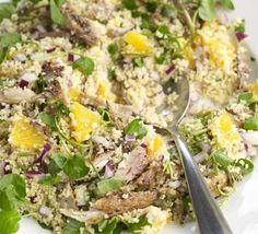 Smoked mackerel, orange & couscous salad. Sliced oranges make a refreshing addition to this substantial salad - great for the lunchbox.