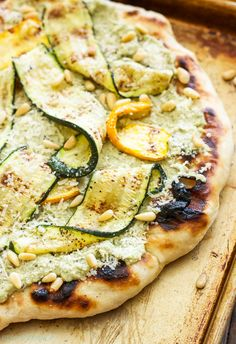 Grilled Zucchini, Ricotta and Pine Nut Pizza   An easy to make grilled pizza topped with zucchini ribbons, ricotta and pine nuts. Perfect for dinner or an appetizer!
