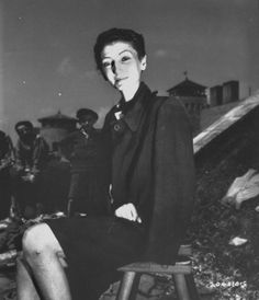 Famed Jewish stage actress, Nador Livia, sits outside Gusen concentration camp after being liberated. Mulhausen, Austria, 1945. (Ignatius Gallo)