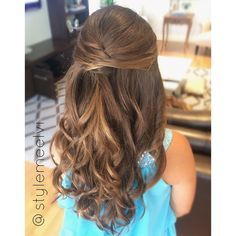 Half up hairstyles are ideal for flower girls and other little one's events. Their hair is still down and youthful, but it's pulled back and out of their face. With the help of lots of spray and bobby pins, their hair will last longer while they're running around on the dance floor  #stylemeelvi #5thgradegraduation