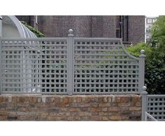 stone walls with privacy lattice | stone walls