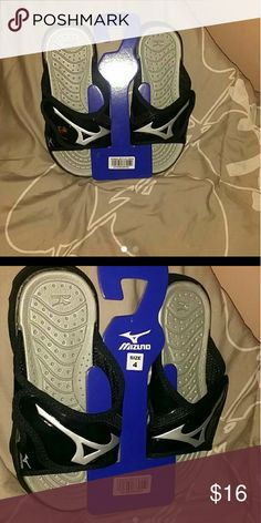 Mizuno slides size 4 mens Brand New Mizuno slides in black size 4 mens.  I would say equivalent to womens 5 or kids 5.  Brand new velcro and comfortable.  Great for volleyball players. Mizuno  Shoes Sandals & Flip Flops