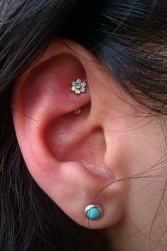 Beautiful rook piercing done by Sarah Conforti at Somatic.