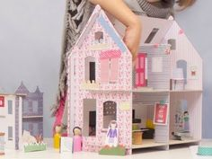 Lille Huset - Cardboard Dollhouses - I think I could make this myself - can cover cardboard with remnant fabric and using some craft paints