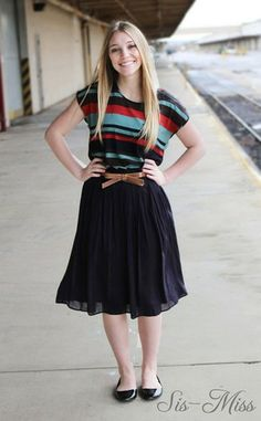 One of Many colors!  Below the knee pleated skirt, with side pockets, and belt.  This skirt can be dressed up or down for every occasion.  http://sis-miss.com/