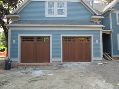 @clopaydoors Reserve Collection Wood Carriage House Style Garage Doors, Design 2 with Sq23 Glass. Installed by Mortland Overhead Door. mortlanddoor.com