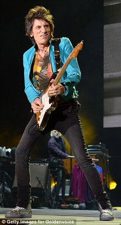 No painting it black: The Stones sported colorful blazers and skinny black jeans for the .