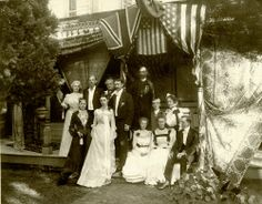 HISTORIC PIC - Taken June 20th, 1901 this wedding party posed on the porch steps of the groom's parents' home at 307 East Second Street.  Mr. Hugh A. Platt was united in matrimony to Grayce Dixie Tidball at 11 o'clock in the morning with the Reverend Arthur of the Episcopal Church officiating.  Hugh's father, William H. Platt, was a man of many distinctions including County Judge, County Clerk, member of the Board of Education, attorney, and 4 time mayor of Grand Island.