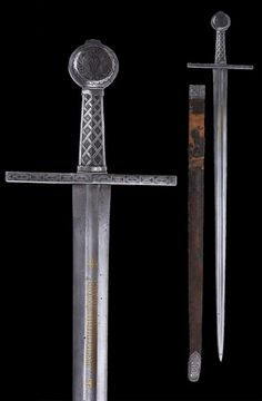 """An Eastern European Medieval Sword with Scabbard, first half of the 14th century The hilt all encrusted with silver (niello). The blade inlaid with gilt inscriptions. The upper back side of the blade engraved with a Mameluk inscription (arsenal of Alexandria). Leather bound scabbard with silver mounts. Overall length: 105.3 cm (41.5""""); Blade length: 88.4 cm (34.8""""); Scabbard length: 89.5 cm (35.2"""") Located at Reichsstadtmuseum Rothenburg, Germany."""