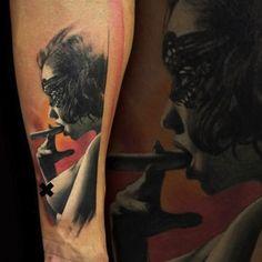 girl smoking cigar by Adam Kremer Prague Czech | arm tattoos