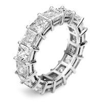 Elegance and sophistication can be yours with this stunning princess cut diamond eternity band. A sparkling array of brilliance is created by princess cut and round cut diamonds that total 4.50 carats. A shimmering spectacle of channel set princess cut plus round cut diamonds are pave set for a dramatic effect. These diamonds go all the way around the band, so even if the ring twist, there will always be diamonds showing.