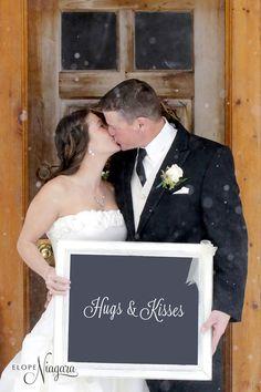 Hugs & kisses for this happy couple at Elope Niagara