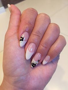 Japanese nail art.  French tip gel with hologram flowers.  Almond shape nails