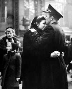 Soldier says goodbye to his Girlfriend before leaving for WWII in Penn Station: 1944 by Alfred Eisenstaedt