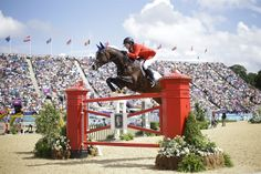 Beezi Madden of the United States competes with his horse Via Volo in the equestrian show jumping