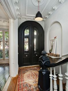 oh my.........MAJOR door envy.......& that ceiling.......oh my.............can i get that banister and railings