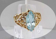 Vintage 14K Gold & Blue Topaz Marquis Ring via Etsy