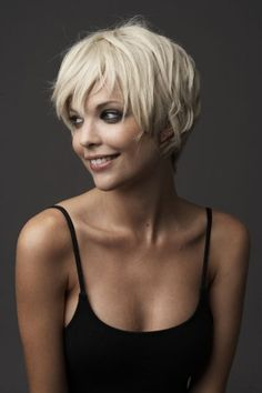 Short haircut with long, gentle layers and light texture around the edges.