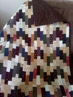 Love the browns in this lap quilt. This was a first.  Learned alot. Alot more to learn.
