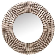Add depth to your living room or master bath with this eye-catching wall mirror, showcasing a layered sunburst shape and silver-colored frame. ...