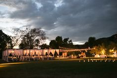 Market Lights, Cabanas and Chandeliers. Moody Wedding Reception Lighting and Luminary - By: LadyLibertyEvents.com  #moderngardenwedding