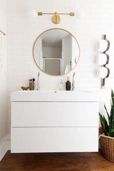 simple for small bath...oval mirror, light fixture, white tile