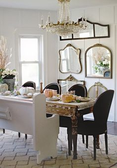 """magicalhome: """"Love this look- an old church pew painted white, a worn table, elegant chairs, and, vintage mirrors on the wall. Classy. Better Homes and Gardens """""""