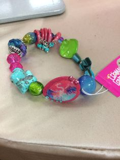 Leoma Lovegrove bracelet- love the colors. Can barely see the flamingo. Love it!
