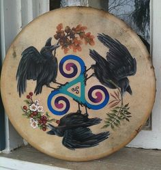 "Handpainted Bodhran Celtic Drum -- Raven Triskele by Bridgid Ashwood on etsy. ""Oak, Ash and Thorn (Hawthorn) have long been associated with Fey/Fairy sacred places and magick. Wherever these three trees grow together it is said that the veil between the worlds is at its thinnest and one might encounter a spirit or fey in that place."""