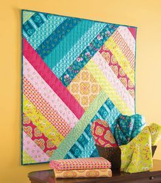 Spin Me Round Wallhanging Quilt - free instructions available to download on website @joanns  #quilting #wallhanging