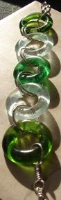Handcrafted upcycled, recycled, green jewelry, wine bottle jewelry, aluminum can jewelry.