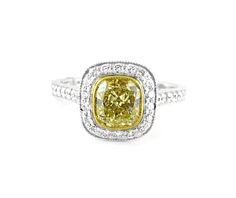 An White and Yellow Gold Fancy Yellow Cushion Cut Diamond Ring Cushion Cut Diamond Ring, Cushion Cut Diamonds, Halo Diamond, Diamond Rings, Diamond Engagement Rings, Yellow Cushions, Halo Rings, Vintage Rings, Colored Diamonds