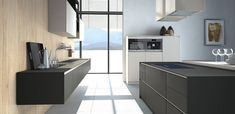 Pronorm | Black gloss kitchen -  visit Alex Lee Kitchens, on Hillmorton Road in Rugby.