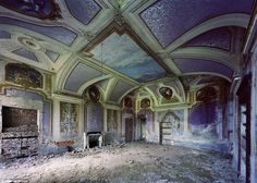 Intricate artwork still adorns the vaulted ceiling of this abandoned property