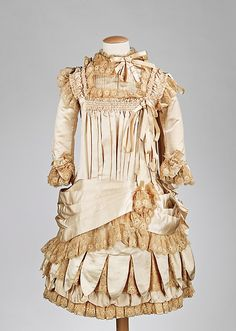 French silk sateen and cotton lace child's dress, c. 1885 ... gift from the Brooklyn Museum to the Metropolitan Museum's costume collection. Photo courtesy the Metropolitian Museum of Art costume collection