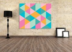 Geometric, cubist inspired art with a fun and bright feel.    30x40cm in size, professionally printed onto cotton canvas and stretched onto a 3cm deep frame, ready to hang in your home.    Also available in, 60x90cm or 90x120cm size.  Artwork by Janette Baker for Wallstudio.