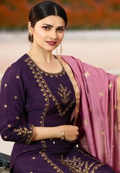 Purple Traditional Embroidered Pakistani Pant Suit shows combination of embossed zari and thread detailed embroidery on heavy georgette satin top paired with fancy santoon pants bottom and lining a. Indian Designer Suits, Designer Salwar Suits, Designer Wear, Pakistani Suit With Pants, Punjabi Suits, Fashion Pants, Fashion Outfits, Kids Fashion, Dashiki For Men