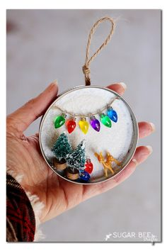 how to make your own mason jar lid snowy scene - this is great for holiday decor or ornaments - - everything miniature is just so extra cute!! - - - Sugar Bee Crafts