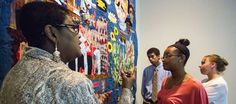 "Marla Jackson, left, discusses ""Still We Rise"" with three of the teens who helped her design and make the quilt, Alyssia Ivory, 17, Topeka, front, Tiffany Jirik, 16, Topeka, and Kenyan Bell, 15, Lawrence, Sunday when the quilt was on display during a special event at the Spencer Museum of Art.  The quilt highlights role of African-Americans in Quantrill's raid and rebuilding Lawrence, KS."