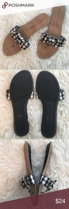 """Marc Fisher Black & White Sandals Super comfy black and white gingham print slides would be great to the office or to an outdoor BBQ. Adorable and in great condition. Worn once on carpet only (see photo #4 for discoloration on toe support). Heel measures 5/8"""" high. Thank you for visiting my closet! Marc Fisher Shoes Sandals"""