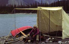 """Bill Mason, canoeing with a traditional """"baker's style"""" canvas tent. Baker leanto are awesome."""