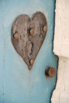 A lock found in Noirmoutier, France. Source: p'titesmith12 on Flickr. | I'd love a door with a custom-made lock just like this.