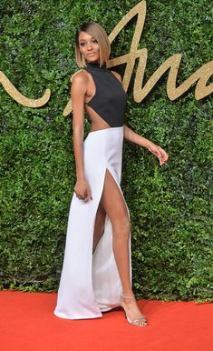 Jourdan Dunn turned heads in a cut-out dress with a black halter top and white thigh-high slit skirt for a stunning outfit.  Sign Up for Our Newsletter